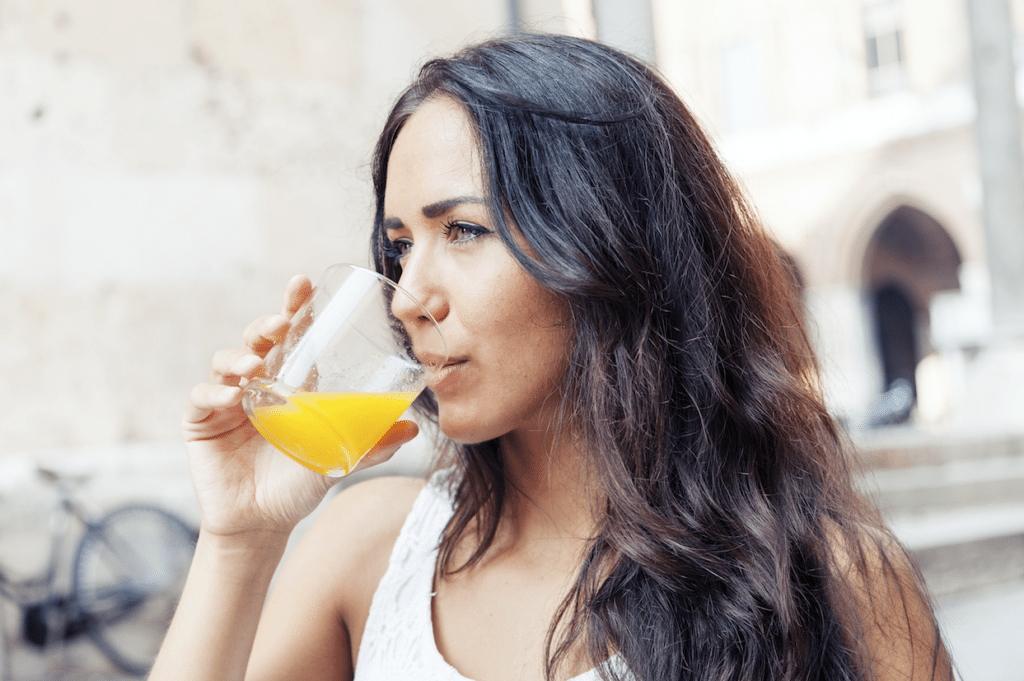 Love of Fiber | Woman Driking OJ